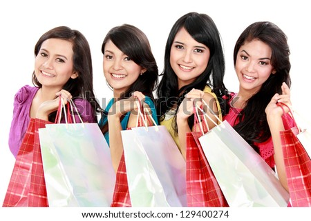 Portrait of happy shopping woman carrying many  shopping bags isolated on white background