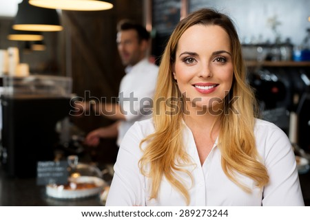 Portrait of happy small business, restaurant owner - stock photo