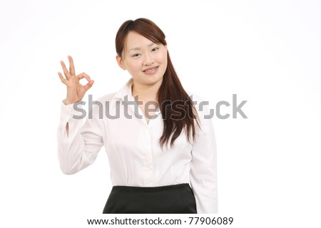 Portrait of happy smiling asian businesswoman with okay gesture
