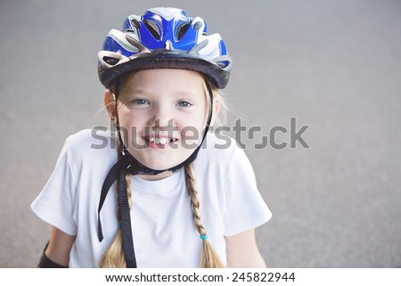 Portrait of happy smiling beautiful girl with helmet and protection on the road, summertime - stock photo