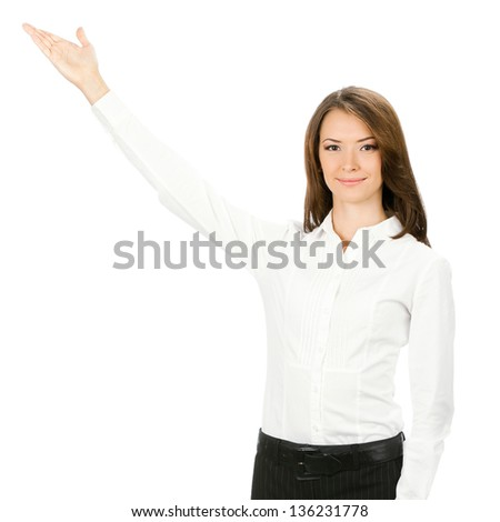 Portrait of happy smiling beautiful young cheerful businesswoman showing something, isolated on white background - stock photo