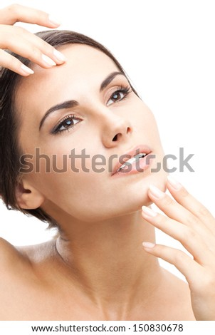 Portrait of happy smiling beautiful young woman touching skin or applying cream, isolated over white background