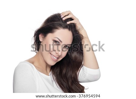 Portrait of happy smiling beautiful young woman with beautiful dark hair isolated over white background. - stock photo