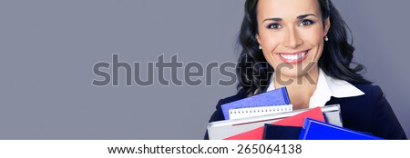 Portrait of happy smiling business woman with folders, with blank copyspace area for text or slogan, over violet background - stock photo