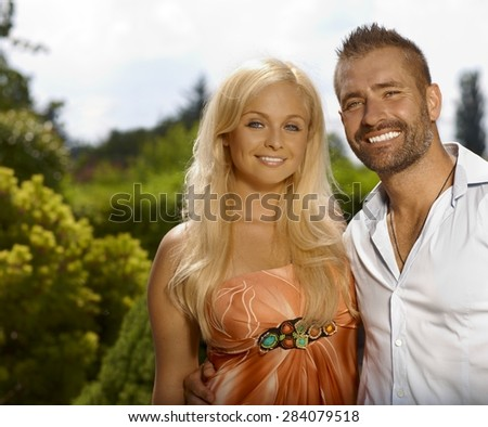 Portrait of happy smiling casual couple outdoor, looking at camera. - stock photo