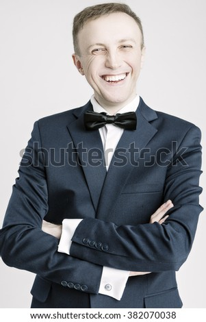 Portrait of Happy Smiling Caucasian Handsome Man in Blue Suite Against White. Vertical Shot - stock photo