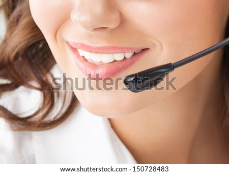 Portrait of happy smiling cheerful beautiful young support phone operator in headset