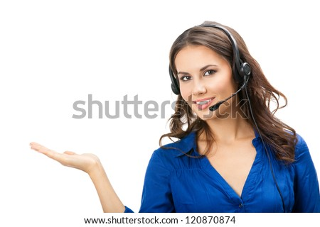 Portrait of happy smiling cheerful beautiful young support phone operator showing; isolated over white background - stock photo