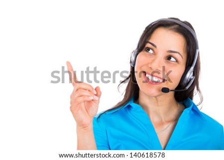 Portrait of happy smiling cheerful customer support phone operator in headset pointing at something, over white background  - stock photo