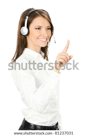 Portrait of happy smiling cheerful customer support phone operator in headset pointing at something, isolated on white background