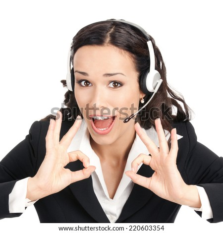Portrait of happy smiling cheerful customer support phone operator in headset showing okay gesture, isolated over white background