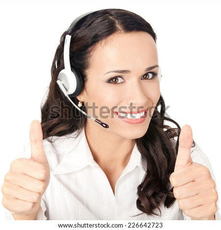 Portrait of happy smiling cheerful customer support phone operator in headset showing thumbs up gesture, isolated on white background