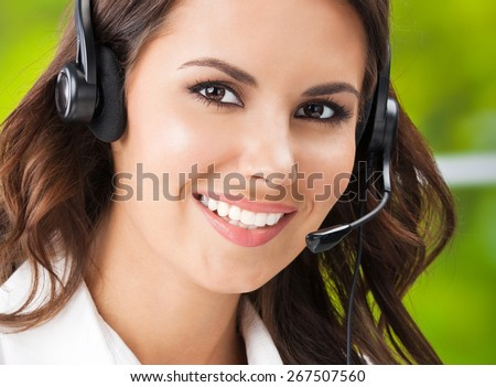 Portrait of happy smiling cheerful young businesswomen, support phone female operator or call center worker, in headset, looking at camera. Help and consulting concept.  - stock photo
