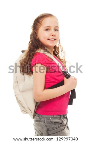Portrait of happy, smiling, confident 9 years old girl with curly hair, wearing backpack isolated on white side view portrait - stock photo