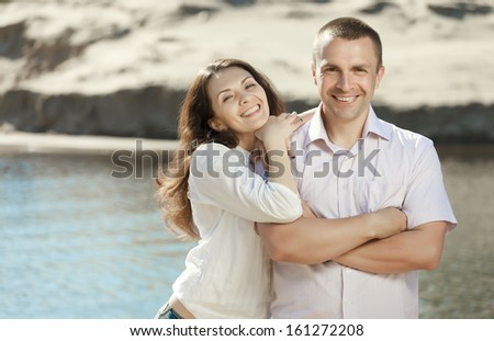 Portrait of happy smiling couple outdoor  - stock photo