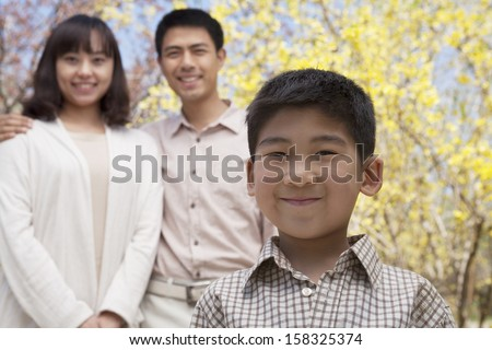 Portrait of happy smiling family in the park in springtime