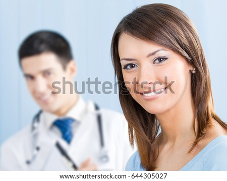 Portrait of happy smiling female patient and doctor at office. Focus on woman. Medicare, health care and medical occupation concept shot.