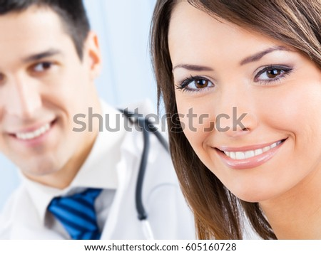 Portrait of happy smiling female patient and doctor at office. Focus on woman. Medicine and healthcare concept.