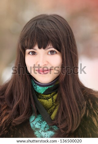 portrait of happy smiling girl in winter - stock photo