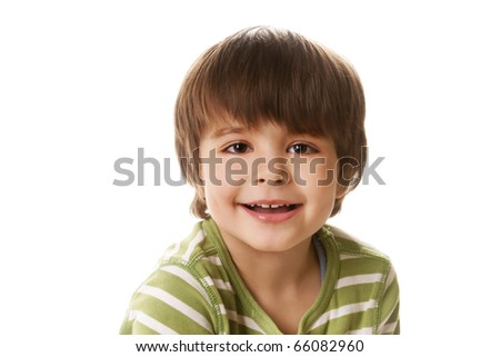 Portrait of happy smiling little boy on white background