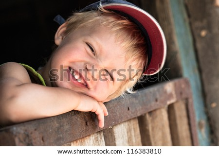 Portrait of happy smiling little boy. outdoors - stock photo