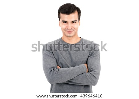 Portrait of happy smiling man wearing casual gray t-shirt, crossing his arms - isolated on white background