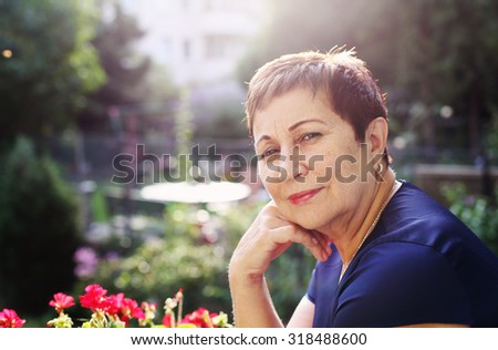 Portrait of happy smiling senior woman - stock photo