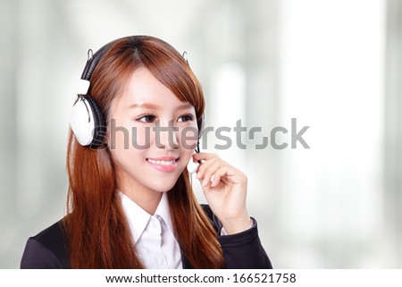Portrait of happy smiling support phone operator in headset, asian - stock photo