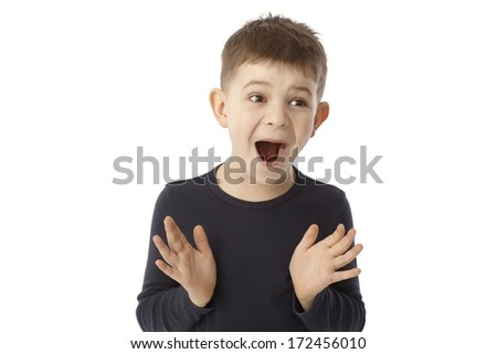 Portrait of happy smiling surprised little boy over white background. - stock photo