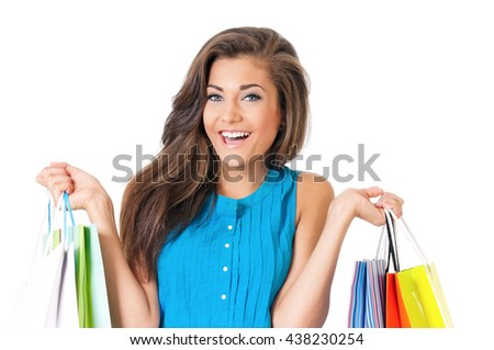 Portrait of happy smiling teen girl with shopping bags, isolated on white background