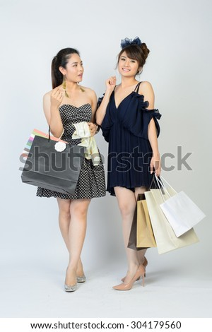 Portrait of happy smiling woman hold shopping bag. Female model isolated studio background. - stock photo