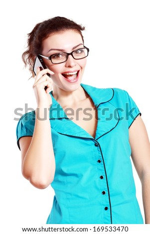 Portrait of happy smiling woman making call in eyeglasses dressed in a blue blouse