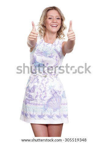 Portrait of happy smiling young beautiful woman in white casual clothing, showing thumbs up gesture, over white background - stock photo