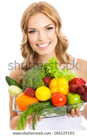 Portrait of happy smiling young beautiful woman with healthy vegetarian raw food, isolated over white background