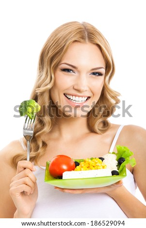 Portrait of happy smiling young beautiful woman with healthy vegetarian salad, isolated over white background