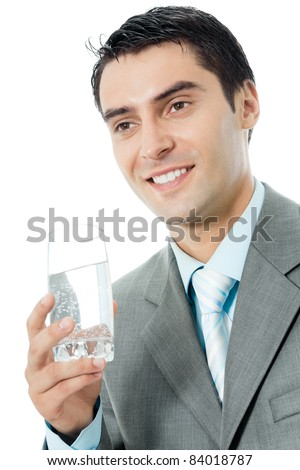 Portrait of happy smiling young business man with glass of water, isolated on white background