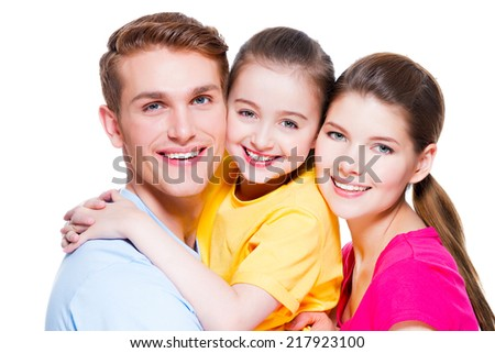 Portrait of happy smiling young family with kid in colored shirts looking at camera - isolated on white. - stock photo