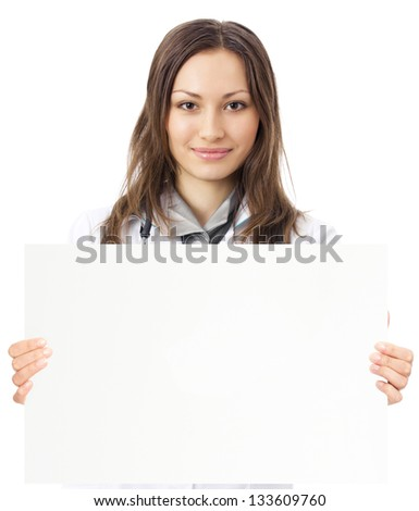 Portrait of happy smiling young female doctor showing blank signboard, isolated over white background