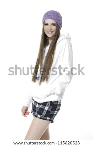 Portrait of happy smiling young model in cap