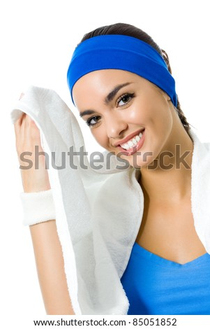 Portrait of happy smiling young woman in fitness wear with towel, isolated on white background
