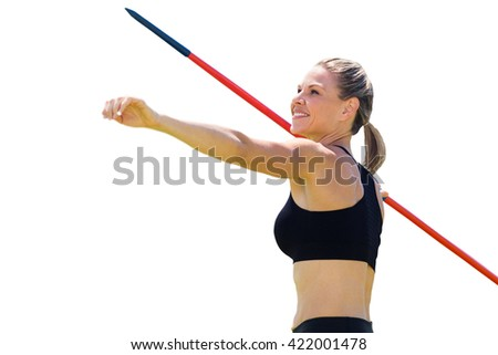 Portrait of happy sportswoman is practising javelin throw