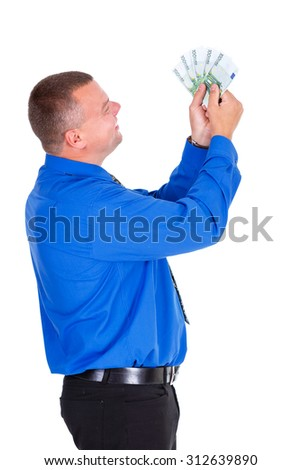 Portrait of happy, successful, lucky business man in shirt and tie holding money euros banknotes in hands. Looking to money. isolated white background. Positive emotion - stock photo