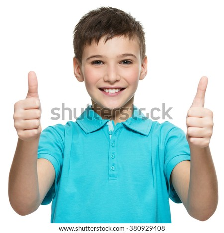 Portrait of happy teen boy showing thumbs up gesture, isolated over white background - stock photo
