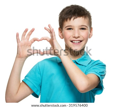 Portrait of happy  teen boy with a heart shape isolated on white background - stock photo
