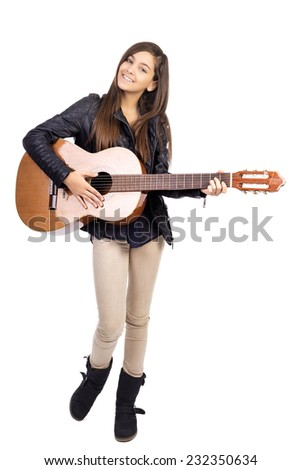Portrait of happy teenage girl playing guitar  isolated on white background