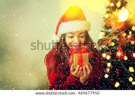 Portrait of happy teenager girl in santa hat