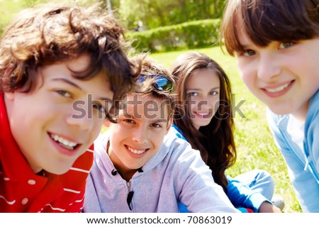 Portrait of happy teens looking at camera in the park at summer