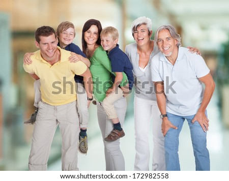 Portrait Of Happy Three Generations Family Standing Together - stock photo