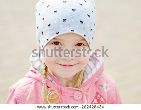 portrait of happy  toddler girl wearing hat - stock photo