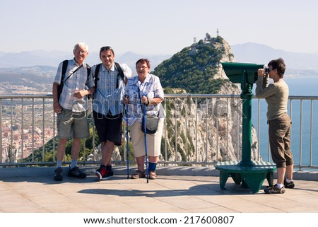 Portrait of happy tourist people on the Rock of Gibraltar.
